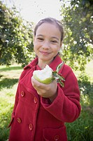 Girl Holding Half_eaten Apple