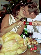 Couple Kissing While Pulling Cracker