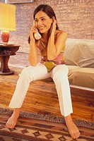 Woman Talking on Telephone at Home