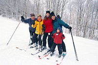 Family on Skis in Snow