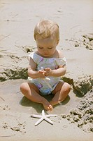 Baby with Starfish at Beach