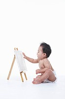 A baby and an easel