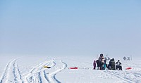 Family fishing on sea ice  Location Oulu Finland Scandinavia Europe