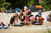 Tourists preparing for river tubing at the Frio River near Concan, Texas, USA