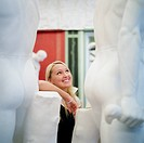 Blond Woman Looking at Nude Sculptures