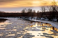 Spring ice flow on the Minnesota River at sunset  The Minnesota River, a tributary of the Mississippi River, flows through the Minnesota Valley River ...