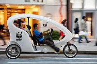 Pedicab taxi on the road, Ginza, Tokyo, Japan