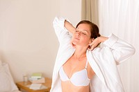 Morning bedroom _ woman in bathrobe and bra