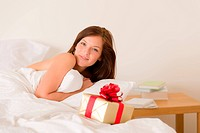 Bedroom surprise present _ young happy woman