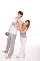 Fitness _ Smiling healthy couple exercising with weights