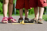 Children walk on a banana peel on the street