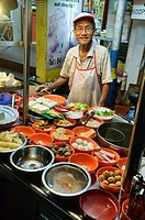 noodles and fishball soup vendor at a hawker court in Penang, Malaysia