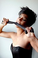 Wild attractive short haired woman bites a belt