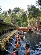 Balinese bath in the sacred waters of Tirta Empul  An ancient natural water spring feeds the baths  This area is believed to be the ancient center of ...