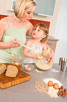 Baking _ Woman with child preparing dough