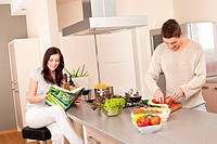 Young couple cooking in kitchen together