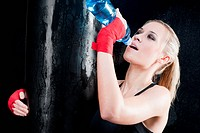 Boxing training woman drink water punch punching