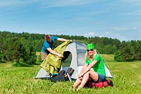 Camping couple build_up tent sunny countryside