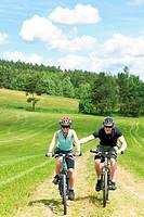Sport mountain biking _ man pushing young girl