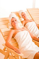 Beauty spa room two women relax sun_beds