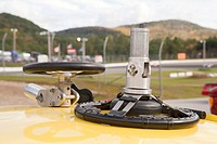 Practice wheel for hand controlled simulator on the top of a stock car for racing
