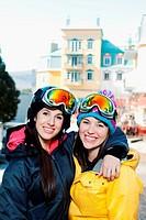 Sisters wearing ski goggles