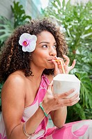 Woman drinking from coconut