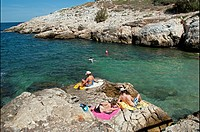 people resting, sunbathing on the cliff, Samena calanque, Mediterranean Sea, Marseille, Bouches-du-Rhone, Provence- Alpes-Cote d Azur, France, Europe