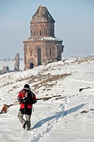 Person walking at the Ancient Ruins Of Ani at winter time, Kars, Eastern Anatolia, Turkey