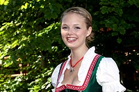Young woman in a dirndl in a beer garden at Pettstatt, Upper Franconia, Bavaria, Germany, Europe