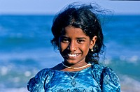 Portrait of a smiling girl on the beach, Mahabalipuram, India, Asia