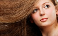 Healthy beautiful long hair closeup in motion created by wind