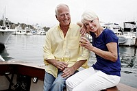 Couple drinking wine on boat