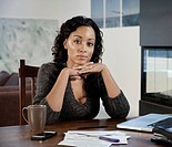Black woman at table with paperwork and paperwork