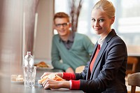 Businesswoman having lunch in a restaurant (thumbnail)