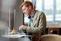 Man sitting in a restaurant taking lunch