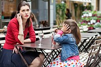 Woman with her daughter sitting in a cafe (thumbnail)