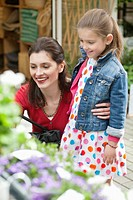 Woman and her daughter looking at flowers in a flower shop (thumbnail)