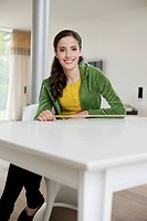 Happy woman sitting at a table