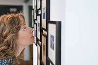 Interior designer looking at a painting (thumbnail)