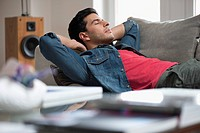 Man resting on a couch (thumbnail)