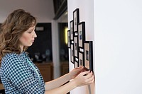 Interior designer measuring painting size