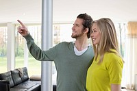 Man showing house interiors to a woman