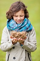 Boy holding a bird's nest