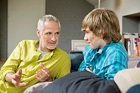 Man talking with his son at home (thumbnail)