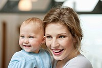 Close_up of a women smiling with her baby girl