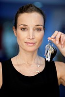 Portrait of a businesswoman holding keys (thumbnail)