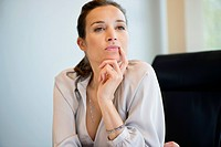 Close_up of a businesswoman thinking in an office