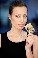 Portrait of a businesswoman holding a credit card