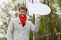 Man holding a speech bubble